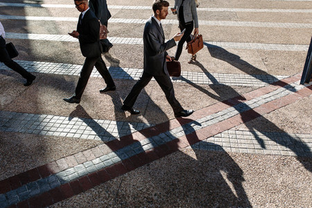 Business people walking to office in the morning on a busy stree