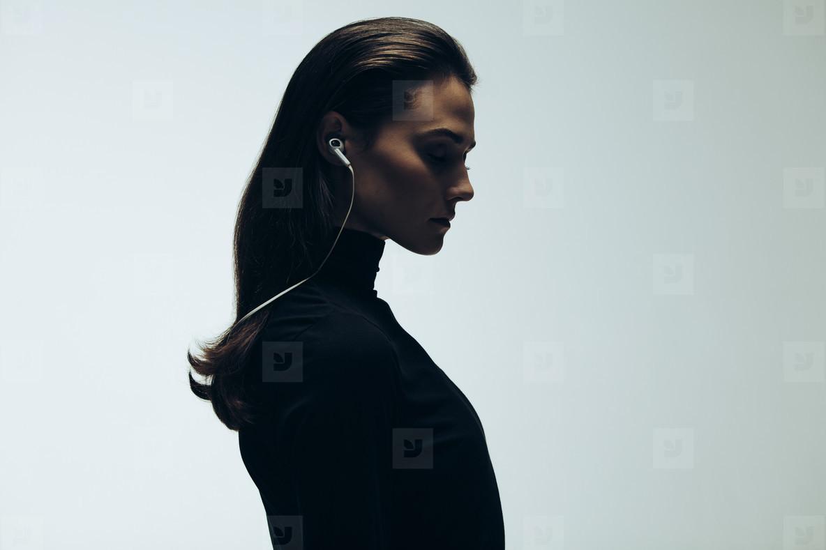Silhouette of female model in studio