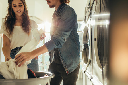 Couple looking at the clothes after wash