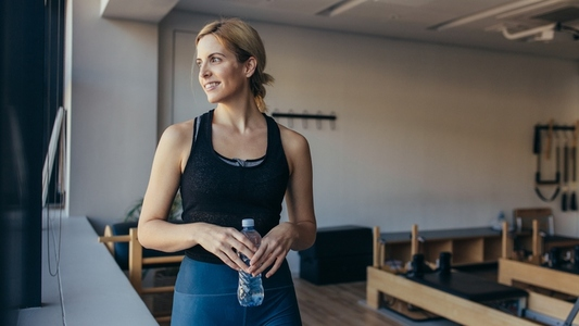 Woman standing in a pilates training gym