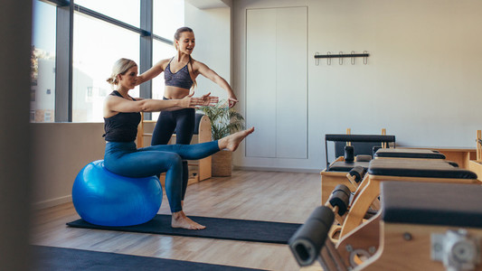 Woman doing pilates training at the gym