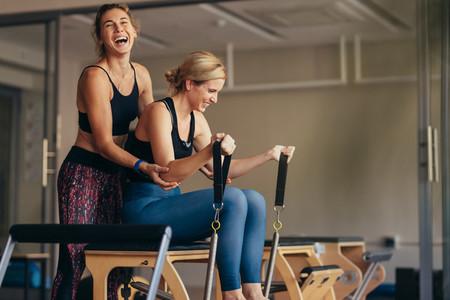 Women having fun while doing pilates workout
