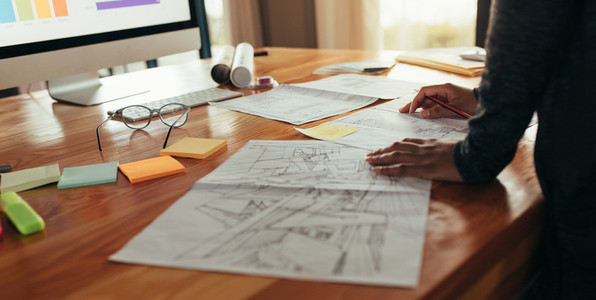 Designer in office working on project