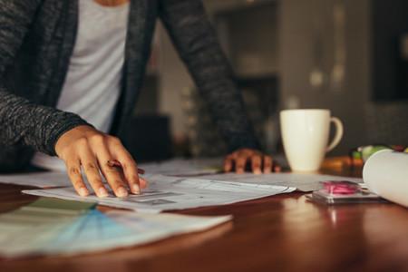 Female designer working on architect project