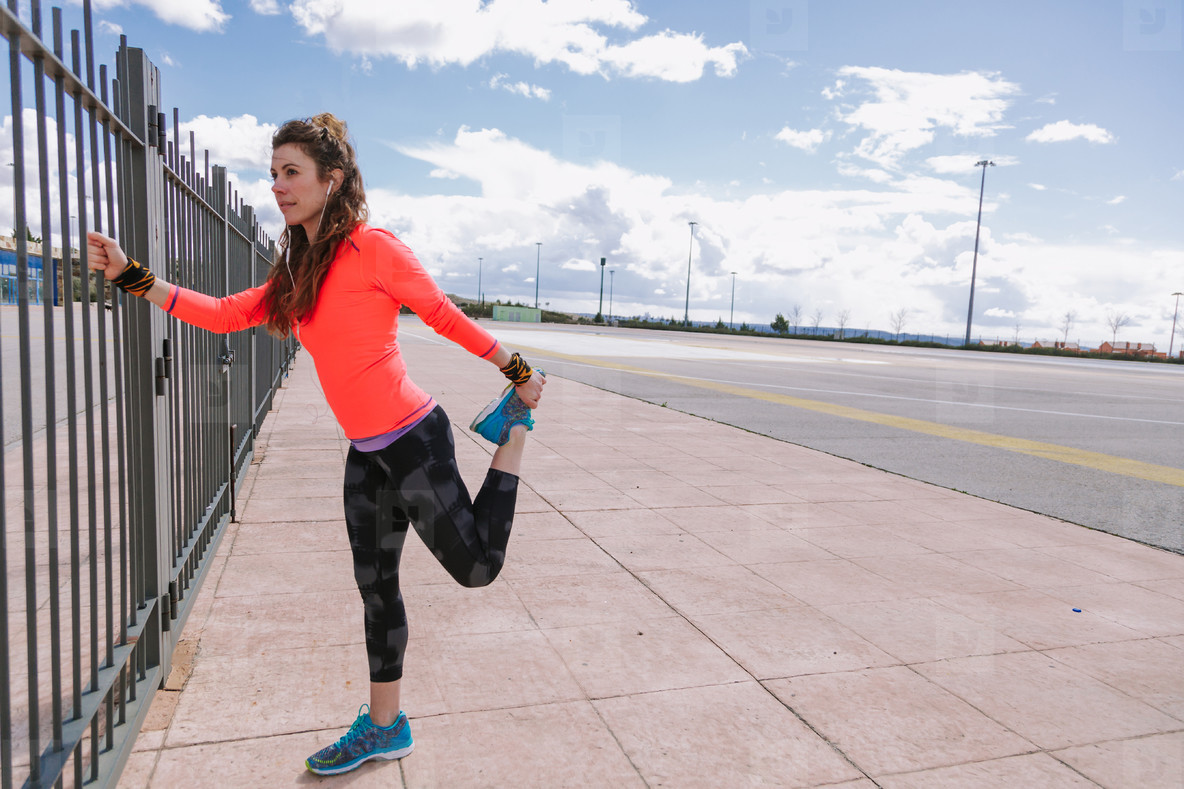 young woman stretching before to run