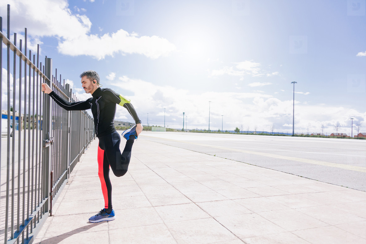 young adult man stretching before to run