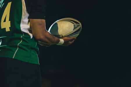 Rugby player with ball in hand
