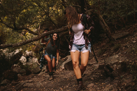 Young people walking through a mountain trail