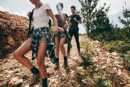 Friends trekking down a hill on a holiday