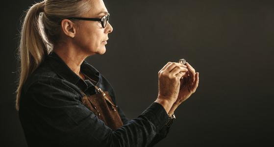 Goldsmith examining the ring