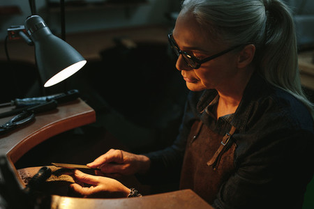 Goldsmith shaping an unfinished jewelry piece