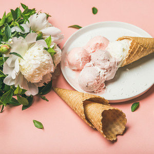 Strawberry and coconut ice cream waffle cones white peony flowers