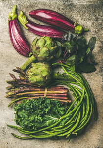 Flat lay of fresh green and purple vegetables