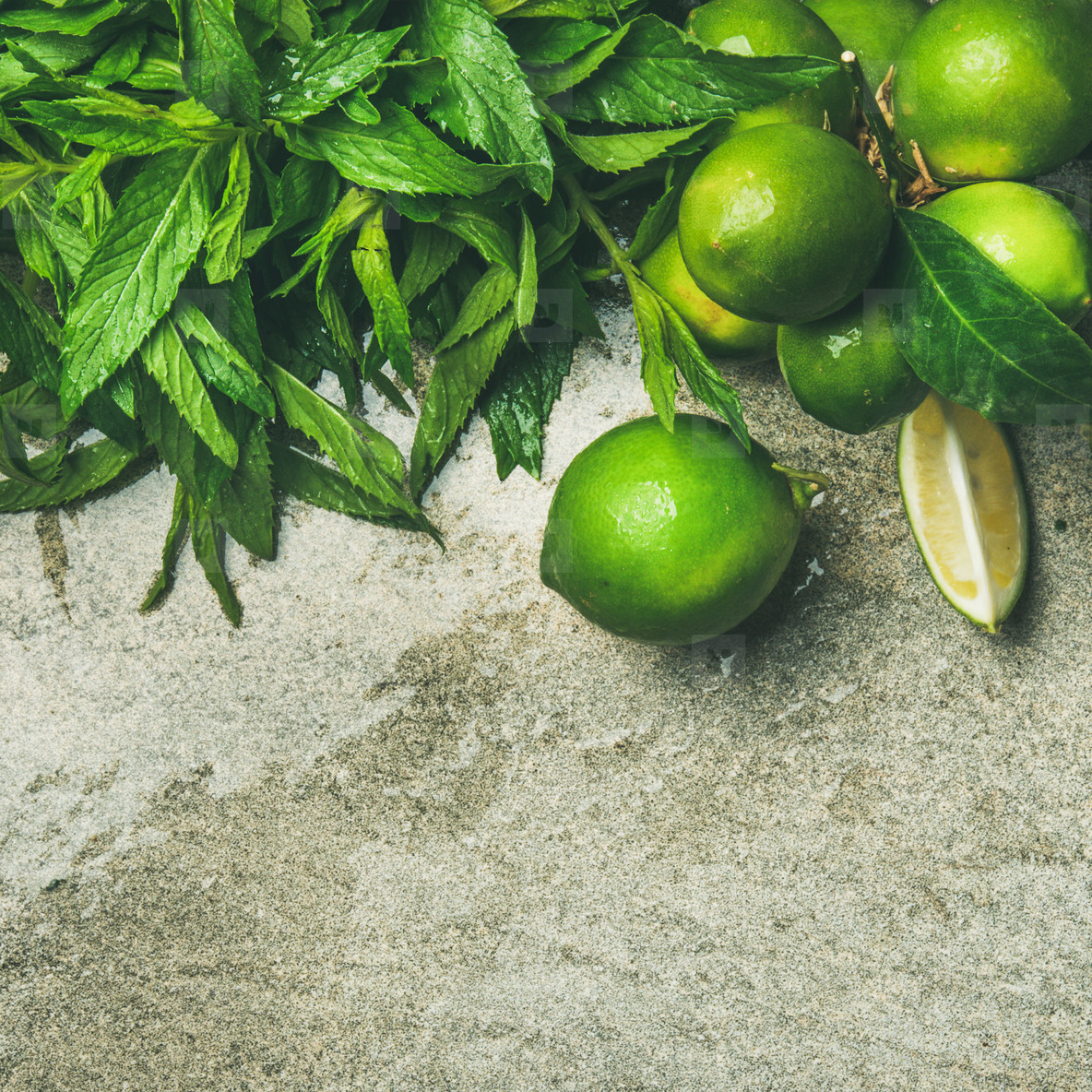 Flatlay of fresh limes and mint for making lemonade