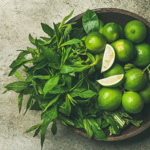 Flatlay of fresh limes and mint top view square crop