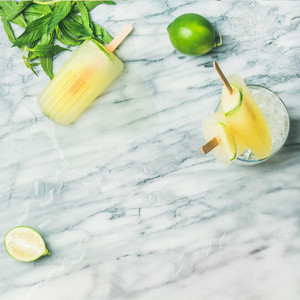 Summer refreshing lemonade popsicles with lime and mint  square crop
