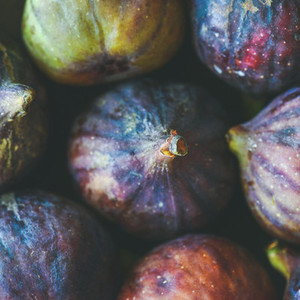 Close up of fresh ripe purple figs  top view  square crop