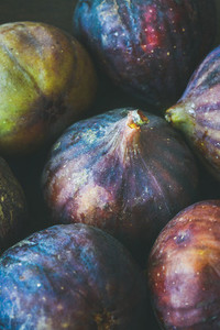 Close up of fresh ripe seasonal purple figs  vertical composition