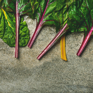 Flat lay of fresh leaves of swiss chard square crop