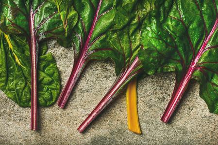Flat lay of fresh green leaves of swiss chard Vegetarian food