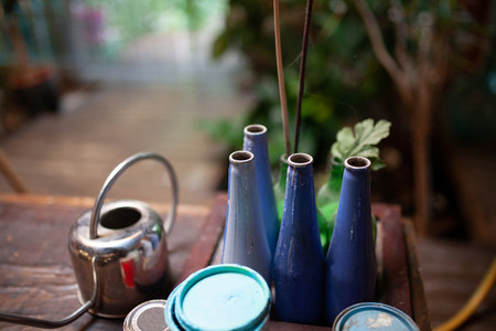 Closeup of bottles painted in blue