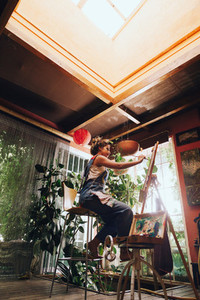 Woman painter painting in her painting studio