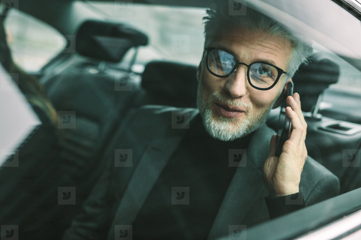 Mature man travelling by a taxi