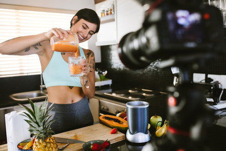 Healthy eating blogger filming new podcast about smoothie