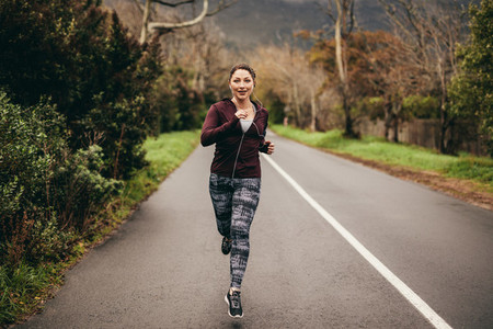 Female jogging on road in morning