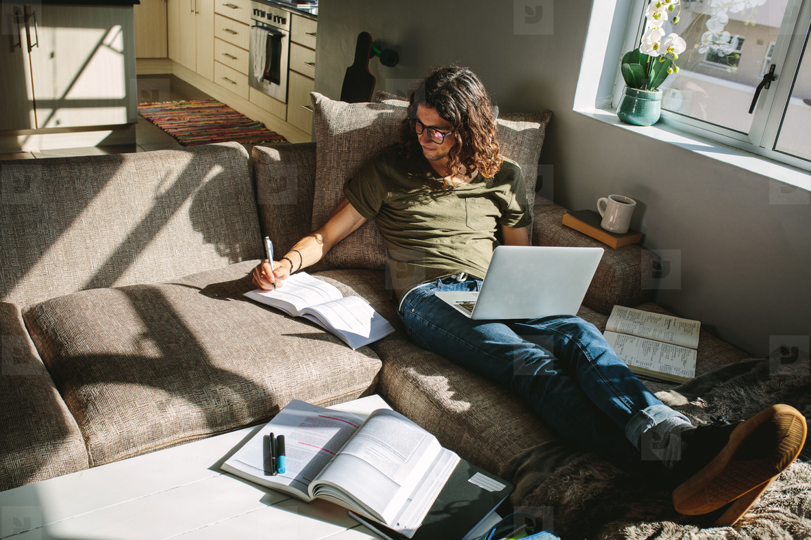 Photos - Student studying at home sitting besi 155890 - YouWorkForThem