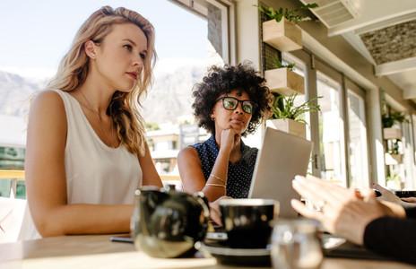 Multi ethnic businesswomen meeting in coffee shop