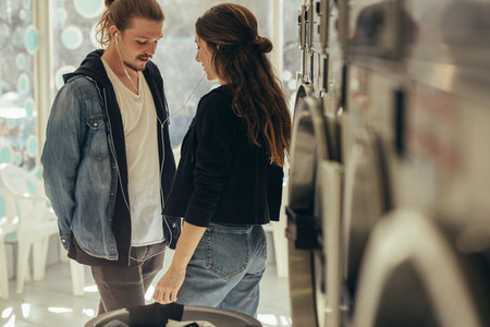 Couple standing in a laundry room