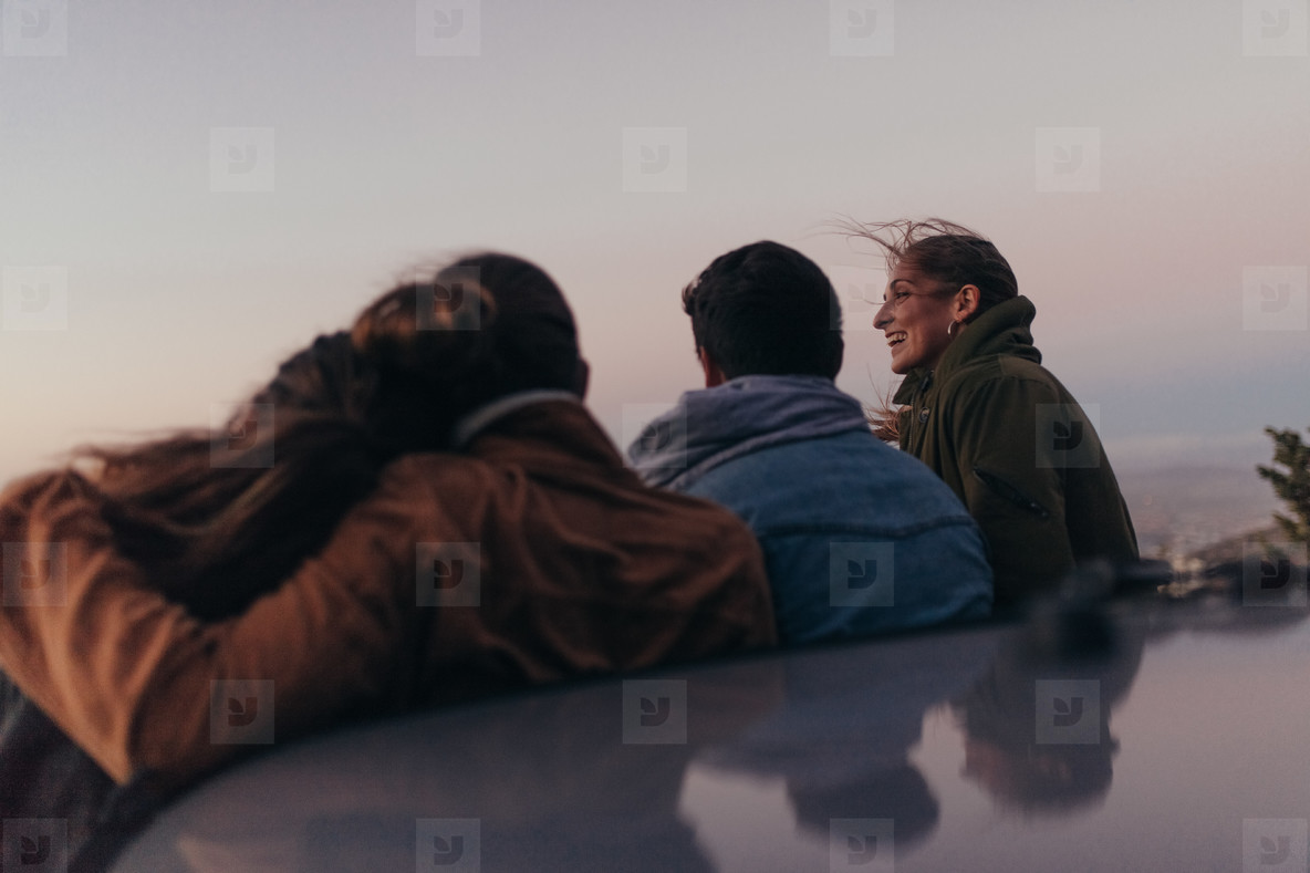 Two couples standing on the hilltop spending time together