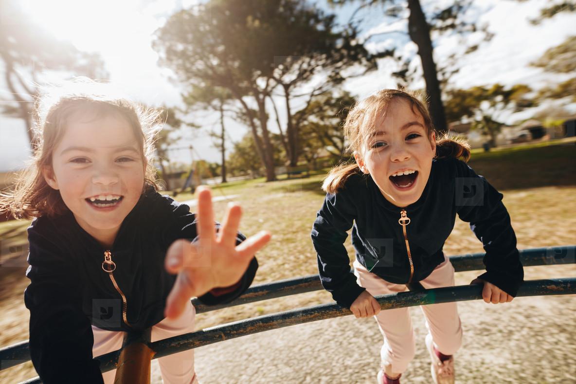 Identical twins having fun in playground