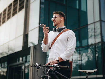 Businessman talking on cell phone standing on street