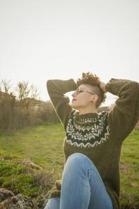 Young redhead woman enjoying nature