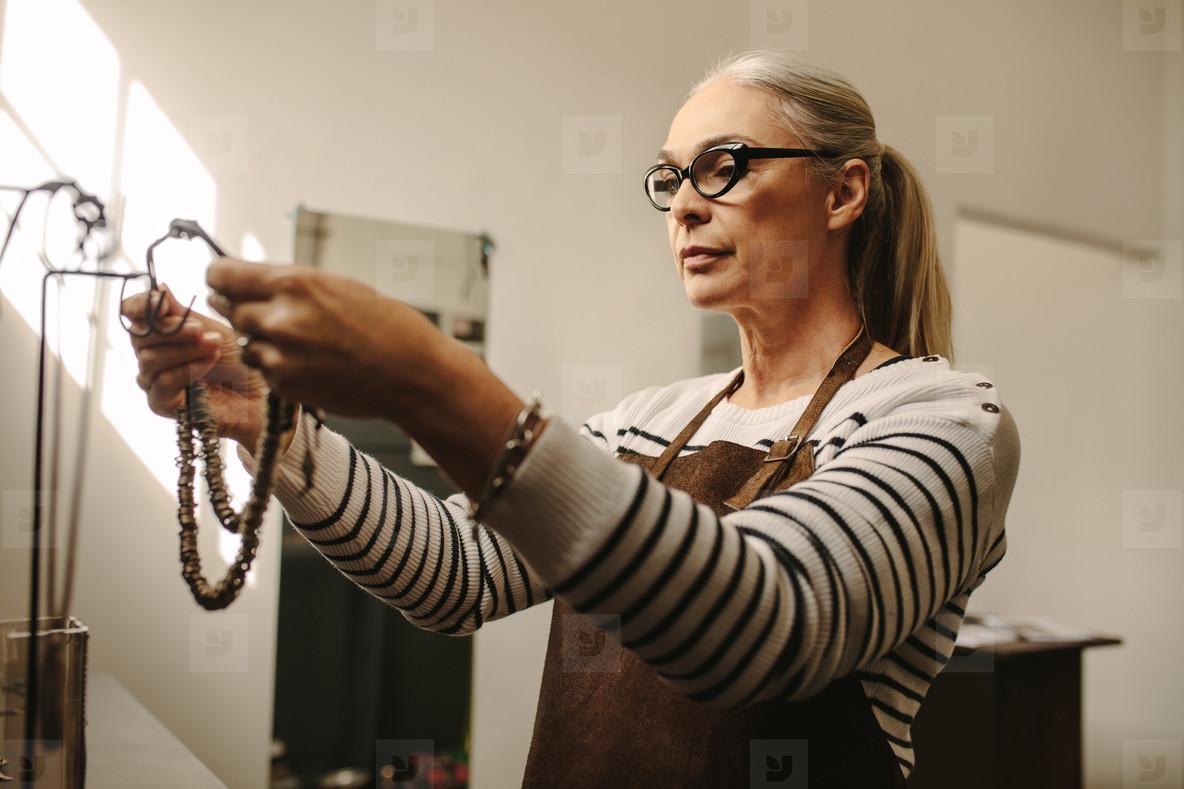 Goldsmith working at her workshop