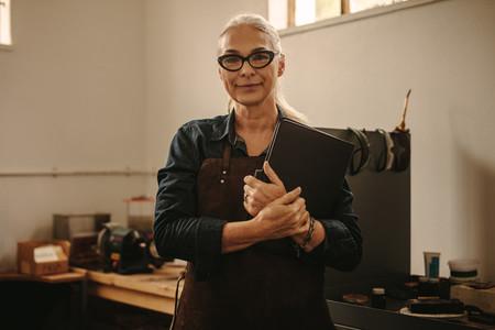 Senior female jewelry designer in workshop