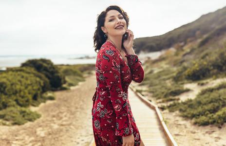 Sensual woman posing against a beautiful landscape