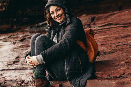 Happy woman relaxing on a mountain