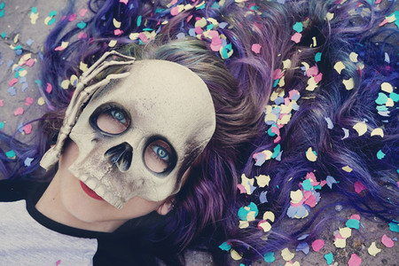 Young woman with a skull mask