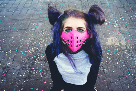 Young punk woman wearing a pink mask