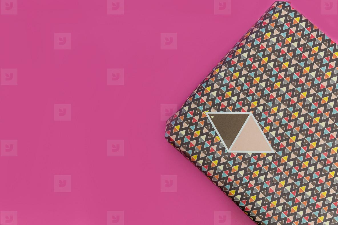 Birthday present gift box pink background
