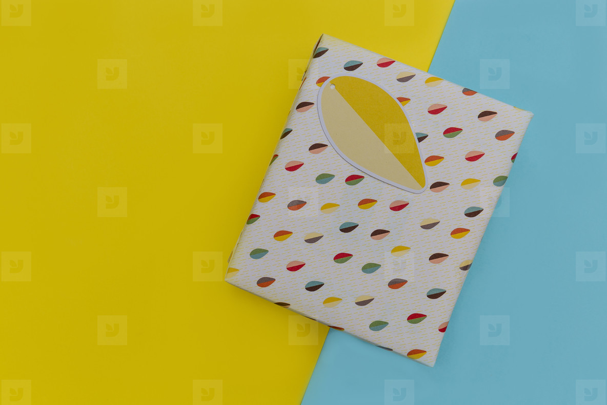 Birthday present gift box yellow blue background