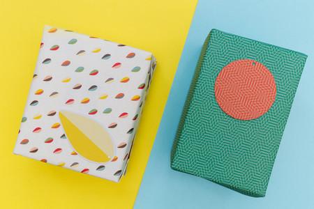 Birthday present gift box yellow blue background