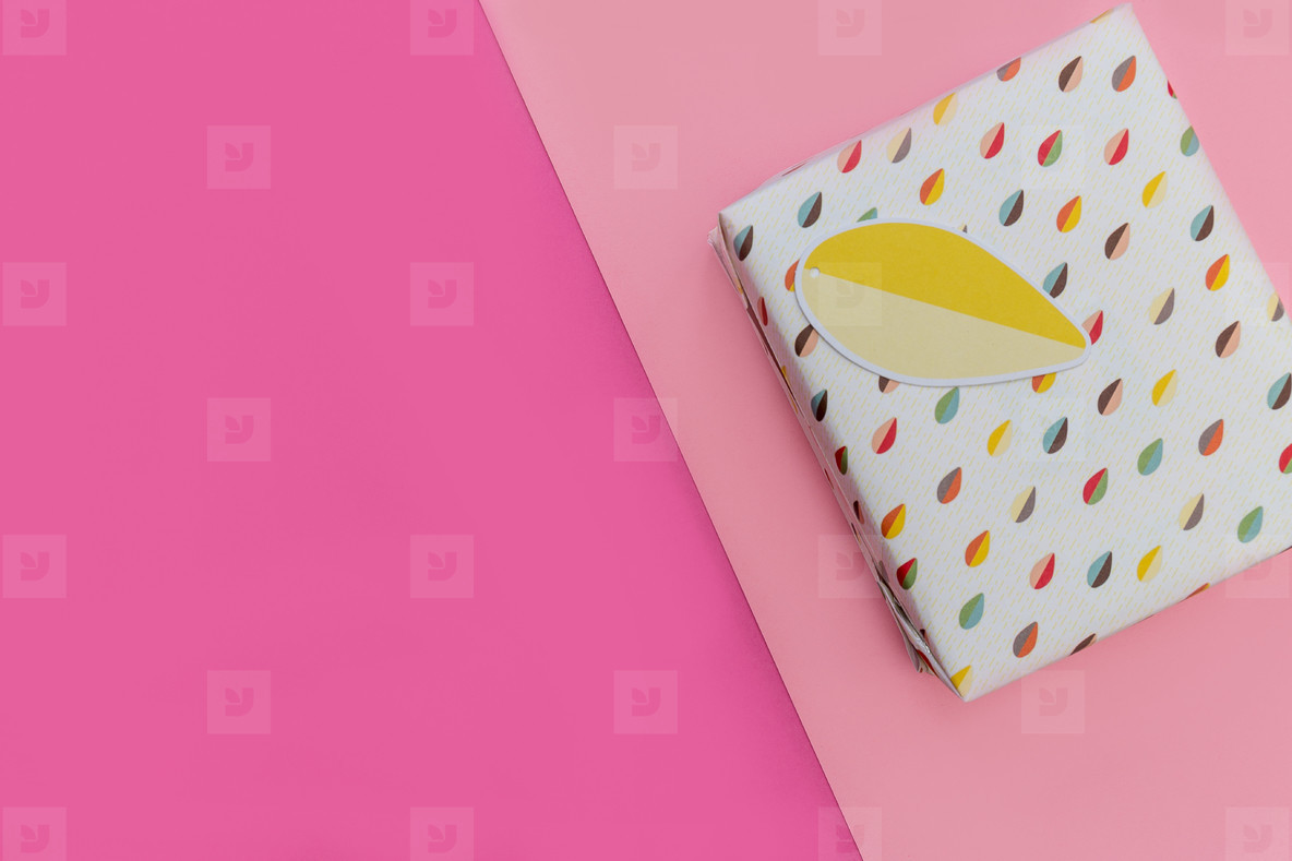 Birthday present gift box pink background copy space