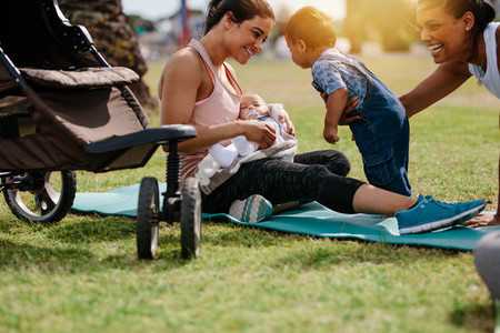 Happy mothers with their babies in a park