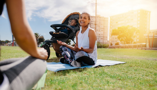 Woman doing yoga sitting in park