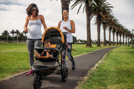 Women walking with baby in a stroller