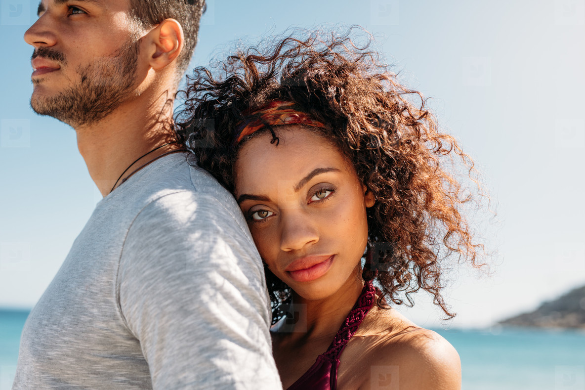 Close up of a woman holding her boyfriend from behind